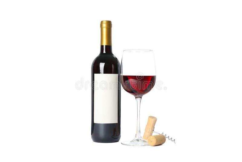 Butelka i szkło z czerwonym winem, corkscrew odizolowywający na bielu obraz royalty free