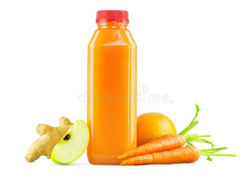 Butelka marchewki, Apple, pomarańcze i imbiru sok, obraz royalty free