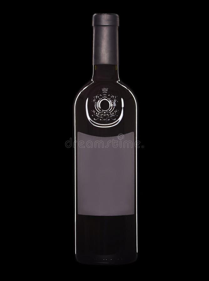 Butelka odizolowywaj?ca na czarnym tle czerwone wino obraz stock