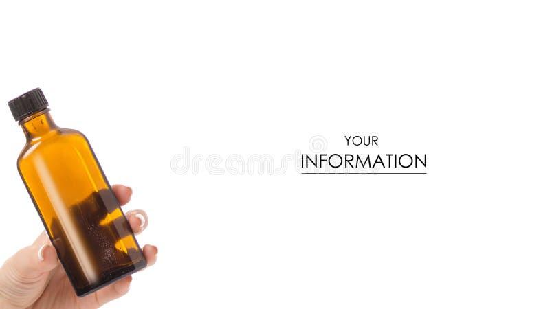 Butelka syrop w ręki medycyny wzorze obrazy royalty free