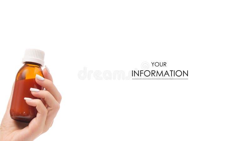 Butelka syrop w ręki medycyny wzorze zdjęcia royalty free