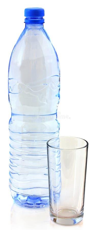 Butelka woda i szkło fotografia royalty free