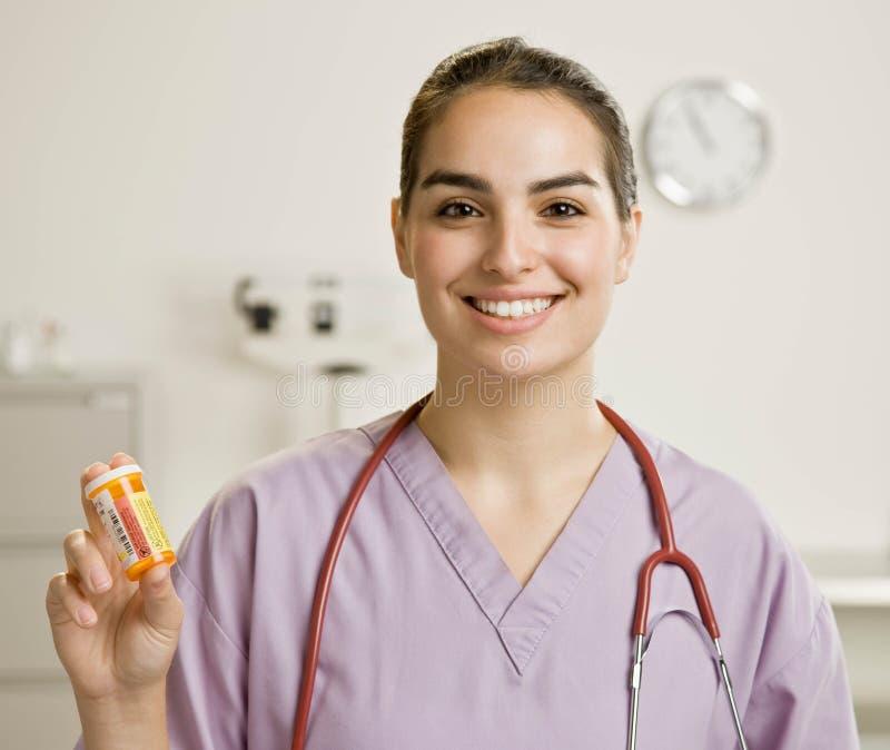 butelki żeńska mienia lekarstwa pielęgniarka żeński obrazy stock