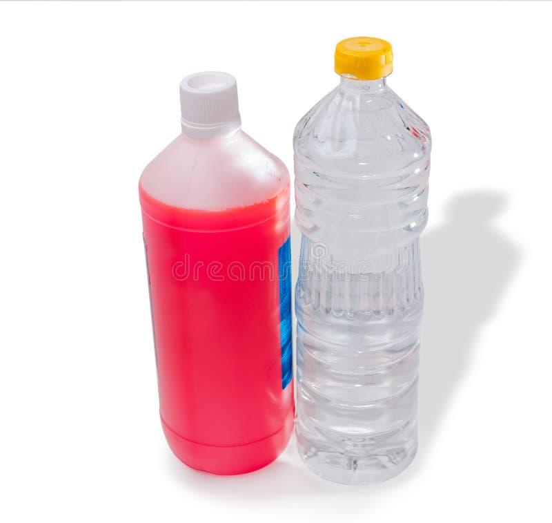 Butelki antifreeze i woda zdjęcia royalty free