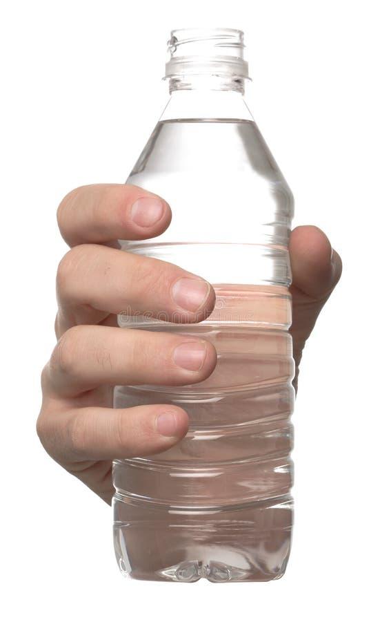 butelki ręki woda zdjęcia stock