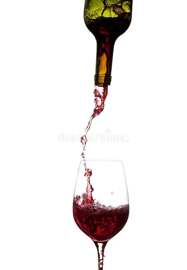butelki szkła dolewania wino zdjęcia stock