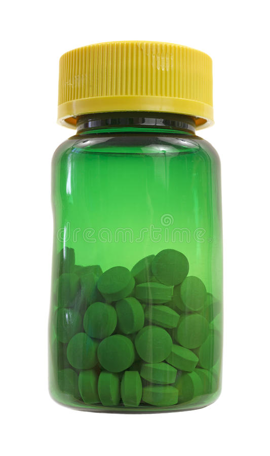 butelki zieleni żelaza pigułki zdjęcia royalty free