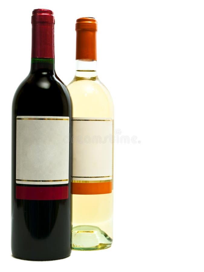 butelkuje czerwonego biały wino fotografia stock