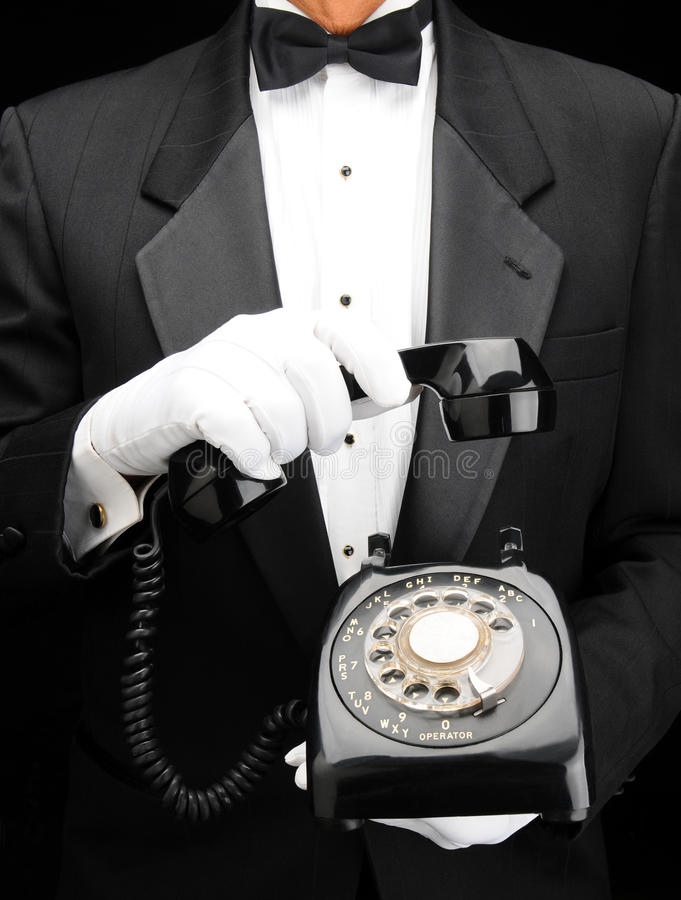 Butler With Dial Phone Royalty Free Stock Images