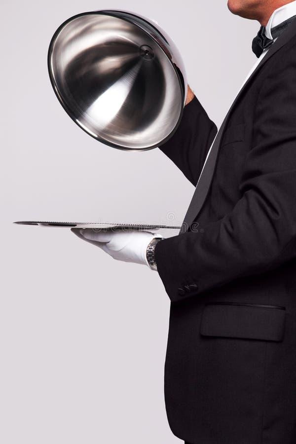 Butler en de zilveren dienst royalty-vrije stock fotografie