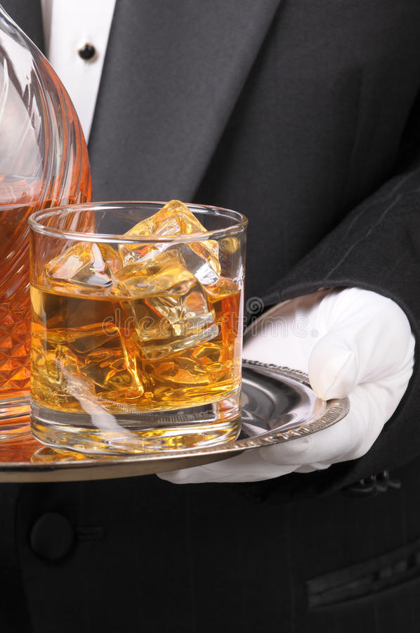 Butler holding Cocktail on tray stock photo