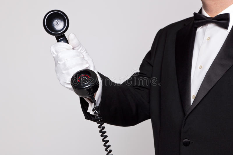 Butler holding a phone handset stock image