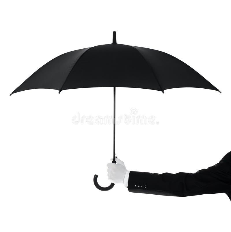 Butler holding an umbrella stock photo