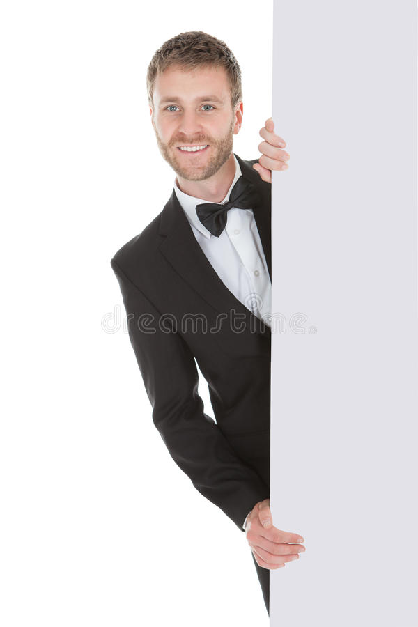 Butler Looking At Blank Billboard stock image