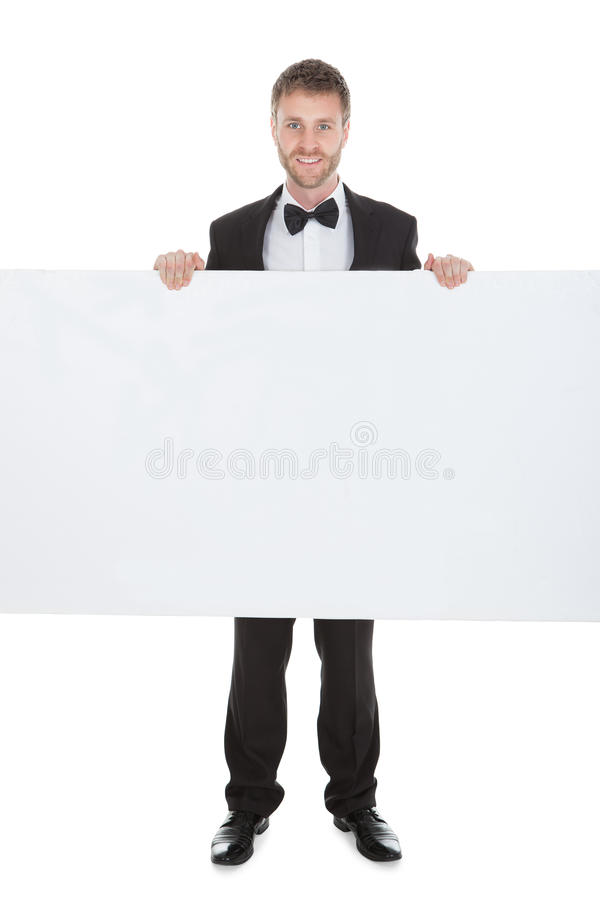 Butler Looking At Blank Billboard royalty free stock photo