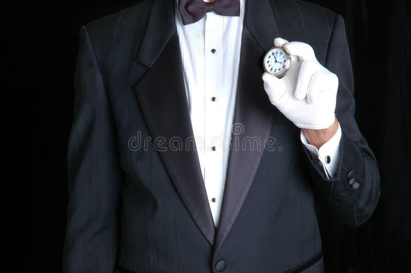 Butler met Horloge stock foto