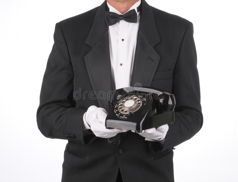 Butler with phone stock photo