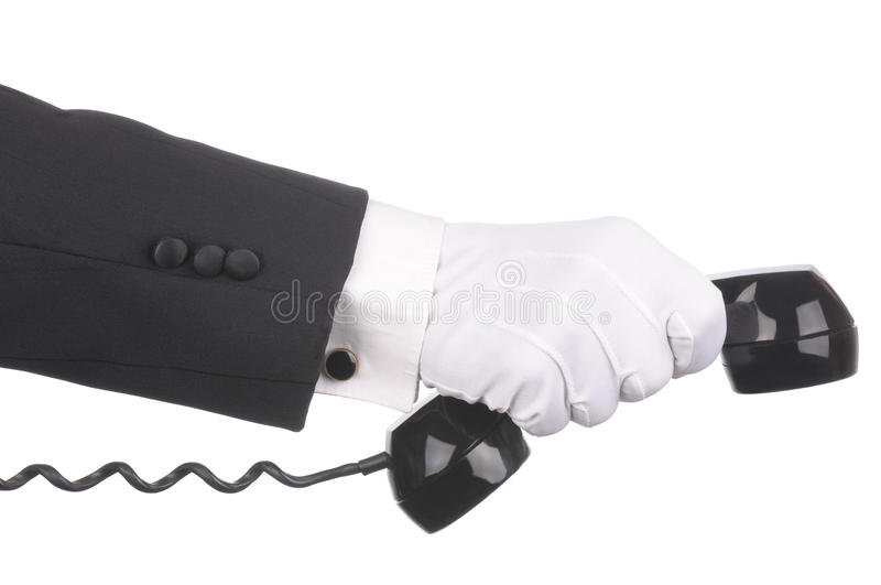 Butler with phone receiver stock images