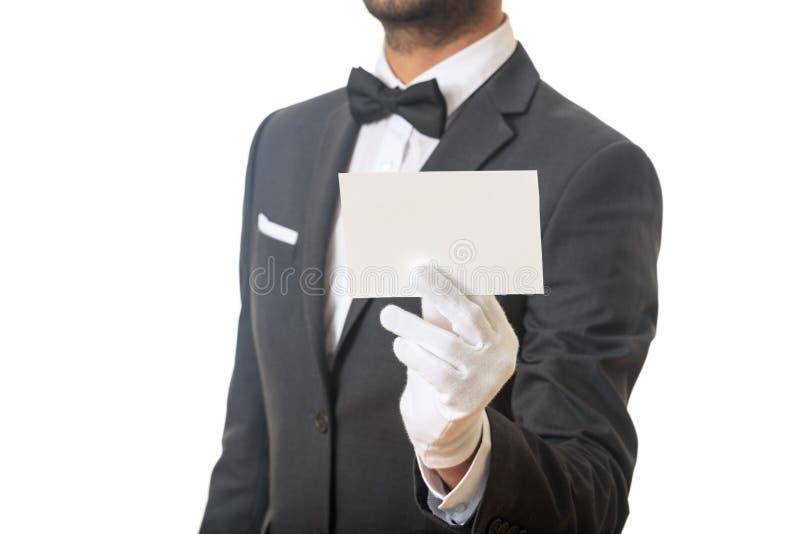 Butler que sostiene una tarjeta en blanco fotos de archivo