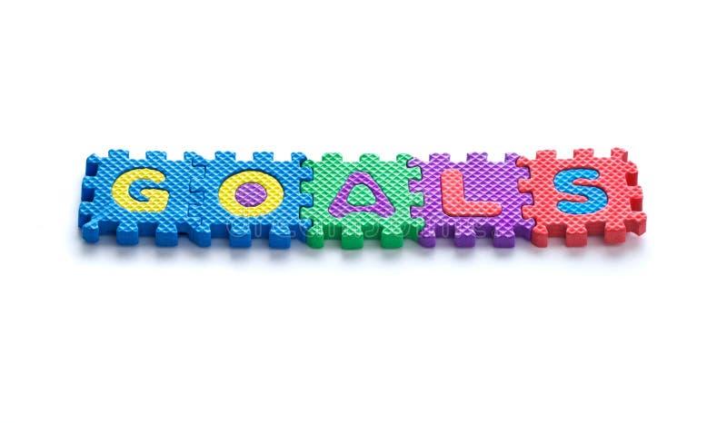 Buts colorés des textes, puzzle denteux de concept d'affaires des textes images stock