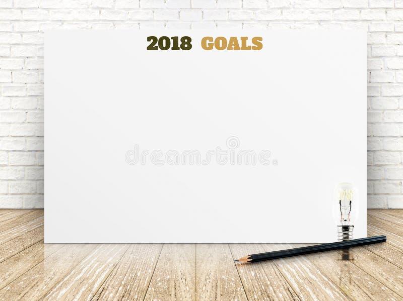 2018 buts de nouvelle année sur l'affiche de livre blanc sur le plancher en bois de planche photos libres de droits