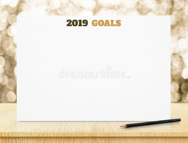 2019 buts sur l'affiche de livre blanc sur la table en bois avec le bokeh l d'or images stock