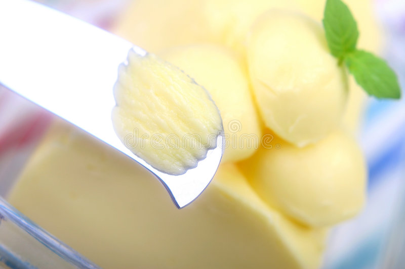 Butter. With mint leaf and  knife stock photos