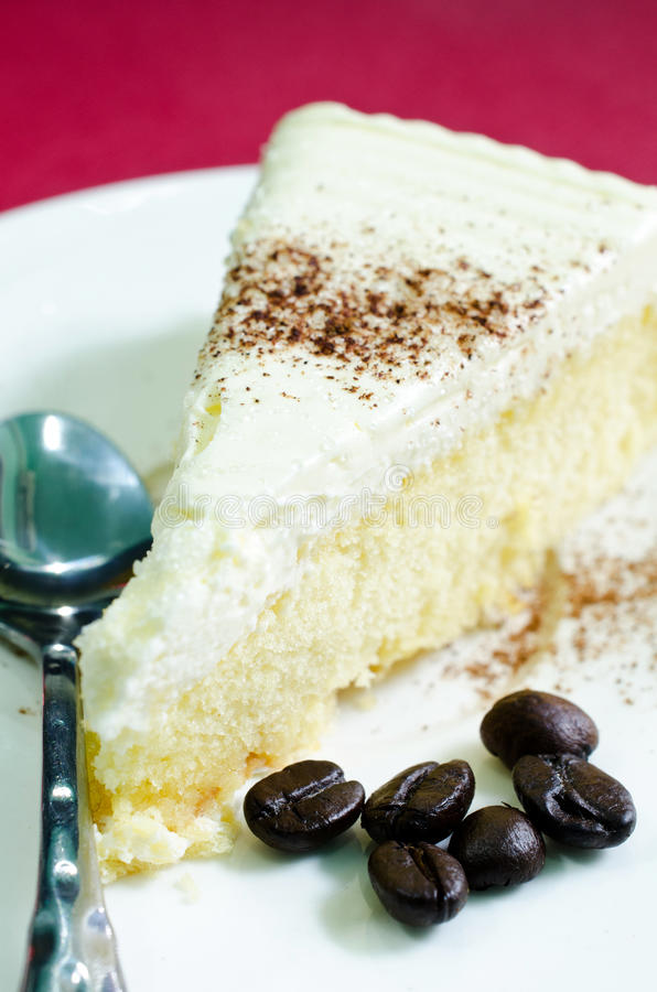 Butter cake. With spoon on white plate stock image