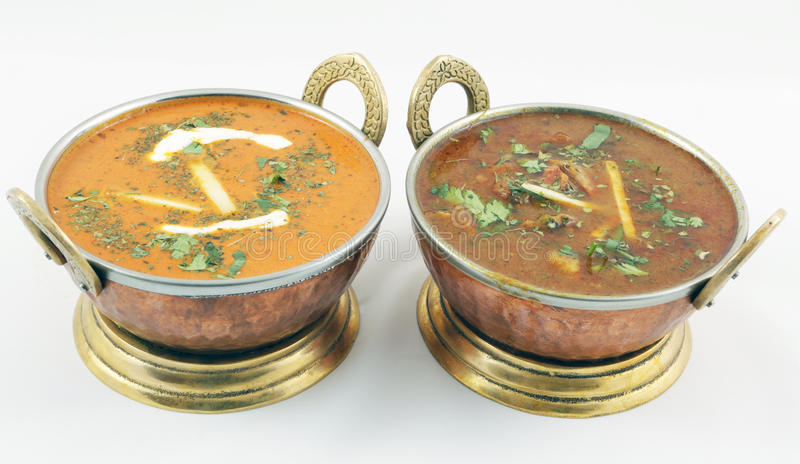 Butter chicken and goat meat curry royalty free stock images