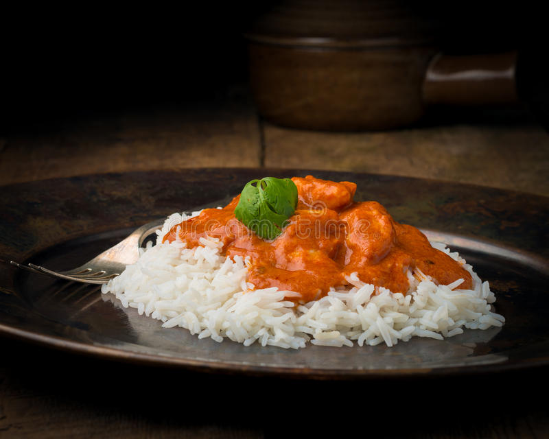 Butter Chicken on Rice Closeup royalty free stock photo