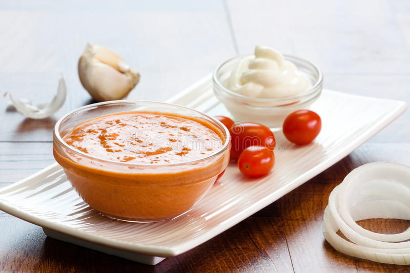 Butter Chicken Sauce. The classic butter chicken recipe used this sauce. Pictured is a bowl of butter chicken and all the ingredients that go into making it this royalty free stock photo