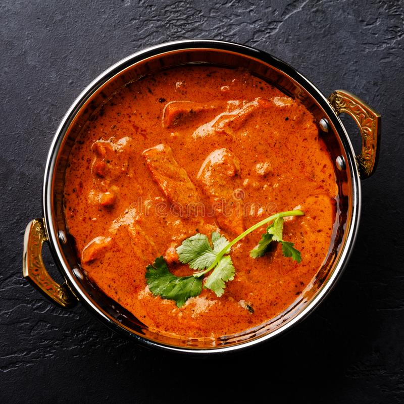 Butter chicken spicy curry meat food in Kadai dish royalty free stock image