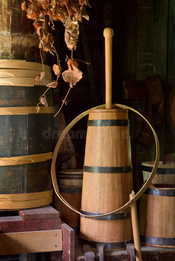 Butter Churn. Old-fashioned wooden butter churn and barrels stock photos