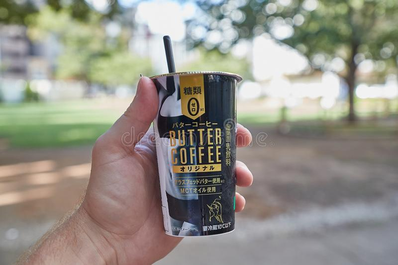 Butter Coffee with MCT oil sold in Japan. TOKYO, JAPAN - SEPTEMBER 7, 2018: Butter coffee sold in a convenience shop in Japan with grassfed butter and MCT oil as royalty free stock photo