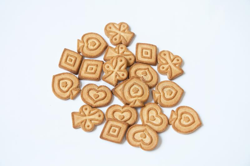 Butter cookies different form on white background stock photos