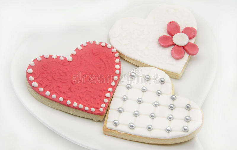 Butter Cookies. With heart shaped fondant decorated royalty free stock photo