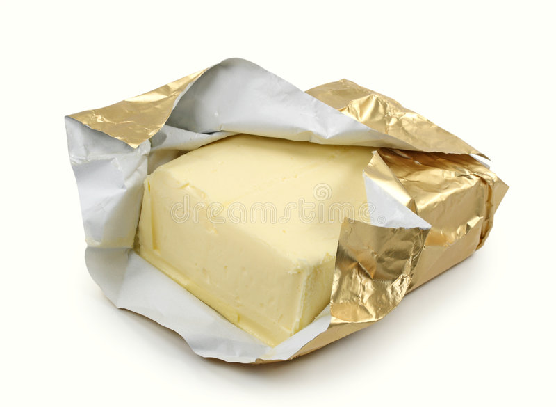 Butter in der Goldfolie stockfotos
