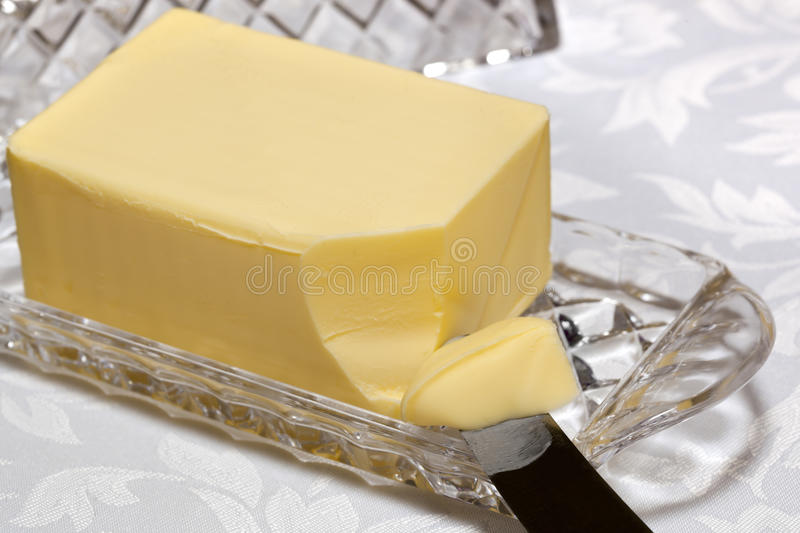 Butter Dish. Butter in crystal butter dish with knife royalty free stock photo