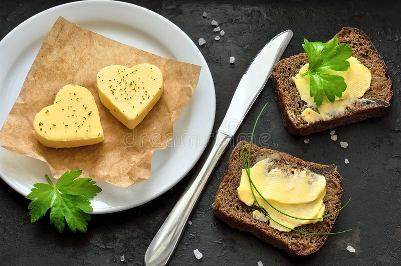 Butter hearts. Two heart shaped peaces of butter stock photos