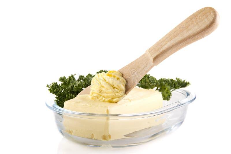 Butter mit Messer lizenzfreie stockfotos
