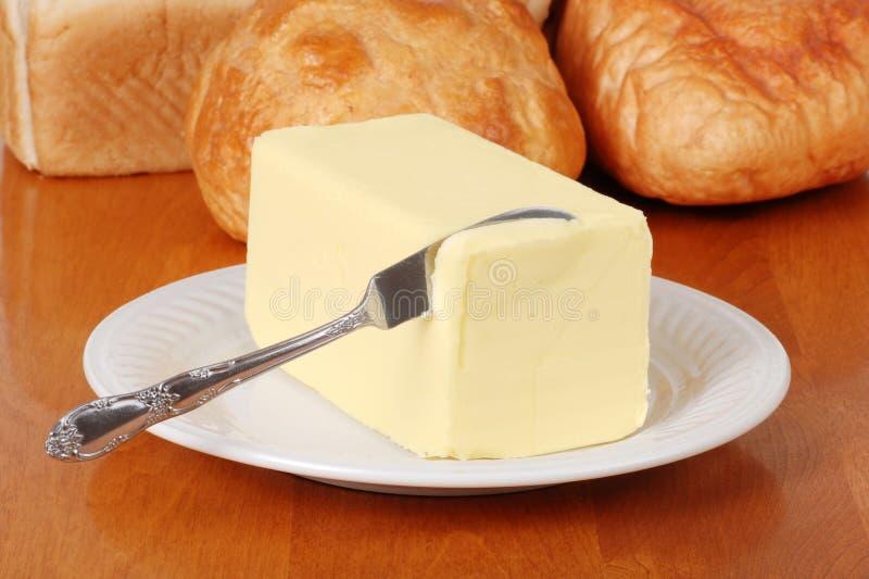 Butter mit Messer stockbilder