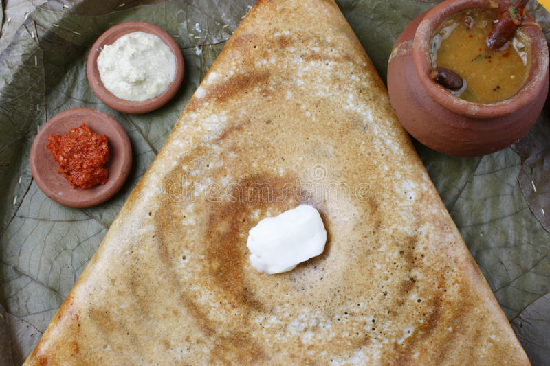 Butter Plain Dosa - a South Indian pancake. The Dosa is a Indian/South Asian delicacy made from rice and black lentils. Dosa is a typical food, eaten for royalty free stock photography