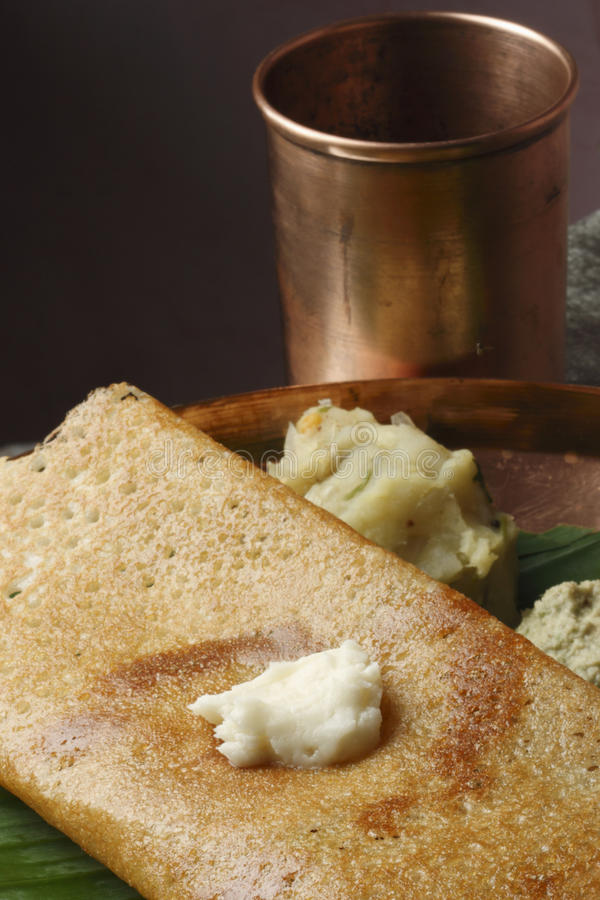 Butter Plain Dosa - a South Indian pancake. The Dosa is a Indian/South Asian delicacy made from rice and black lentils. Dosa is a typical food, eaten for stock images