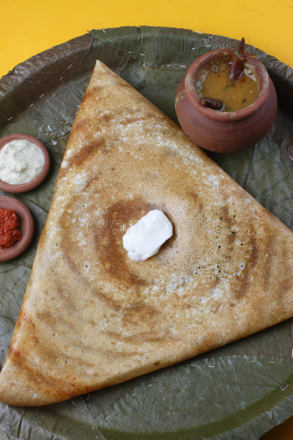 Butter Plain Dosa - a South Indian pancake. The Dosa is a Indian/South Asian delicacy made from rice and black lentils. Dosa is a typical food, eaten for stock photography