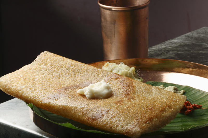 Butter Plain Dosa - a South Indian pancake. The Dosa is a Indian/South Asian delicacy made from rice and black lentils. Dosa is a typical food, eaten for stock photos