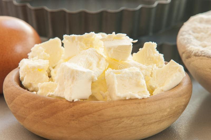 Butter on white wood table. Close up royalty free stock image