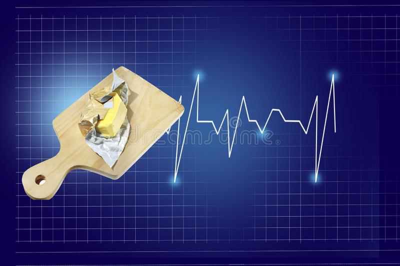 Butter on a wooden board with a heart beat rate chart info and healthcare report, isolated on blue background with checkered lines stock photo