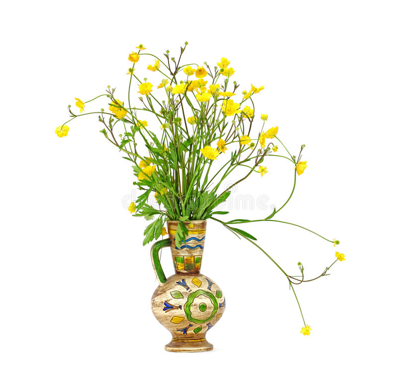 Buttercup Flowers In Colorful Vase Royalty Free Stock Photos