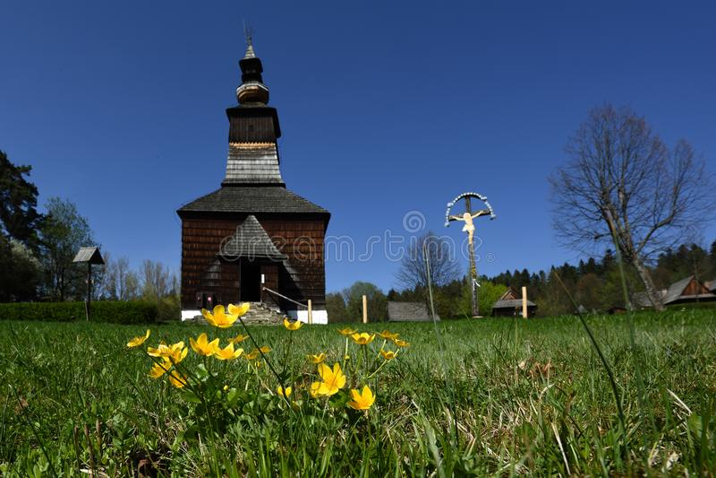 Buttercups at Folk Church, Spis region, Slovakia stock photography
