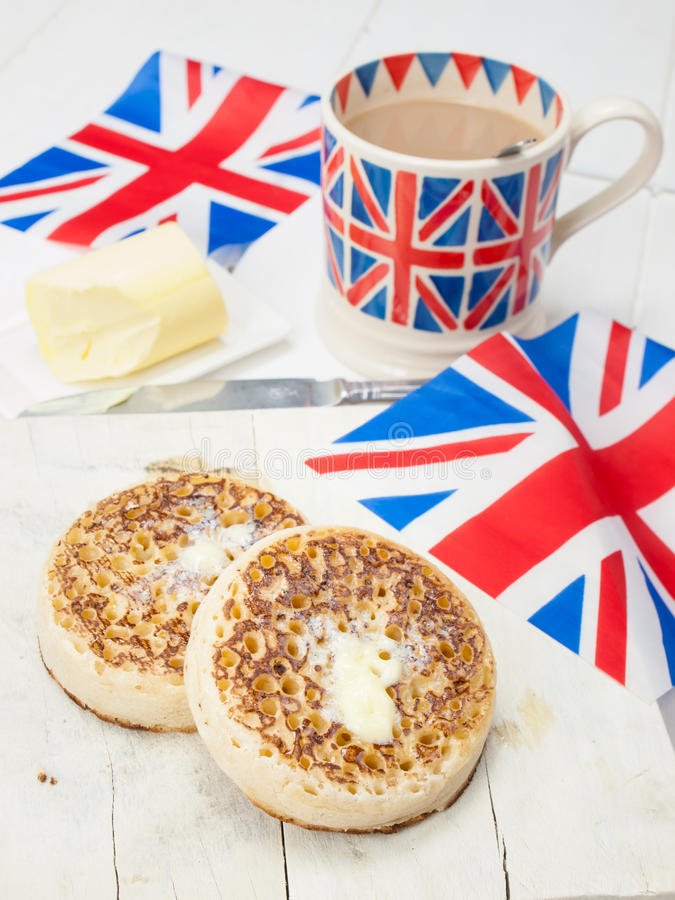 Download Buttered English Crumpets With Cup Of Tea And Flag In Closeup Stock Photo - Image: 41281200